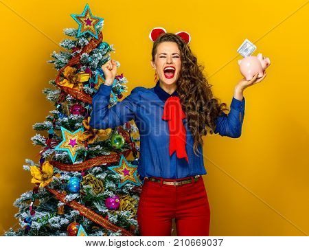Happy Woman With A Piggy Bank With A Dollar Bill Rejoicing