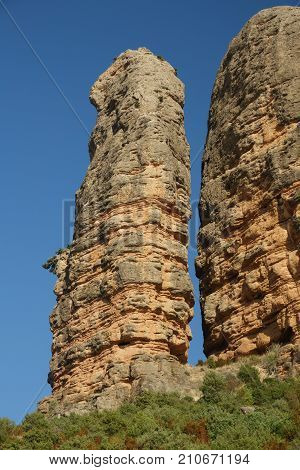 Wide angle view of the vertical cigar chape rock in Aguero, Huesca, Spain