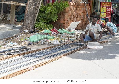 PONDICHERY PUDUCHERY INDIA - SEPTEMBER 03 2017. An unidentified indian worker man welding metal rod for house construction. Concept of manual labor very hard.