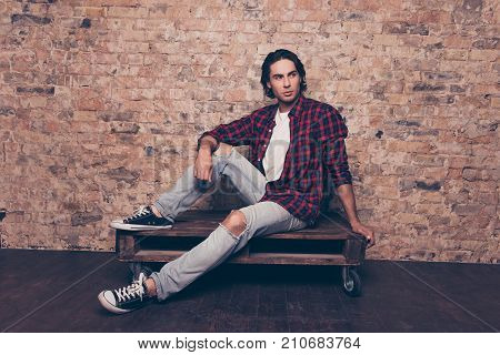 Full Length Of Young Successful Freelancer Student On The Brick Stones Wall Background, Sitting On T