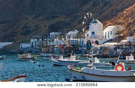 Village With Port On The Island Thirassia, Santorini, Greece.