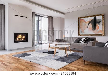 Modern living room with fireplace sofa balcony and pattern carpet