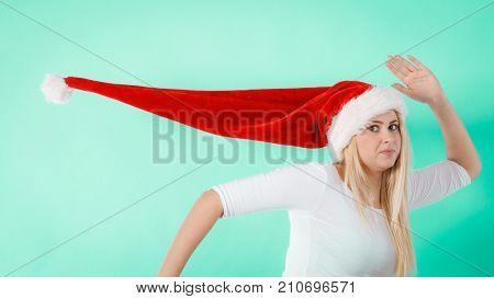 Woman Wearing Windblown Long Santa Hat