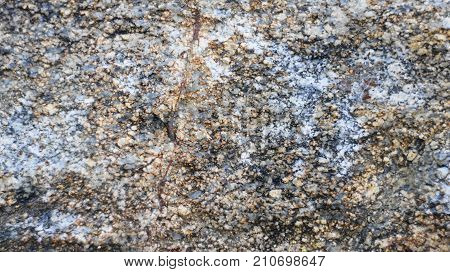 The surface of black granite, a large lump of which was brought to the park for further sculptural processing.