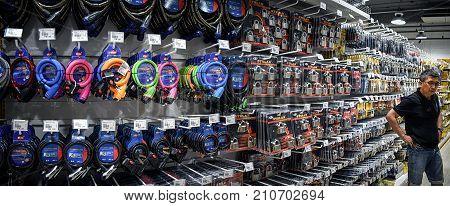 BANGKOK THAILAND - OCTOBER 22: Customer shops for locks in the aisle in Mr. DIY hardware store located in Victoria Garden in Bangkok on October 22 2017.