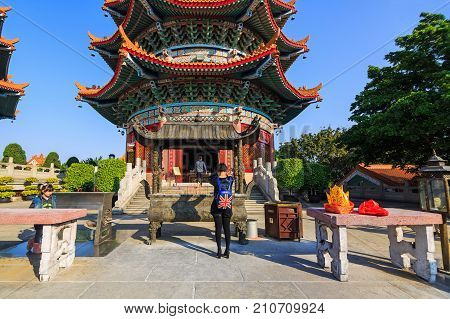 GUANGZHOU CHINA - 01 JANUARY 2015 - People come to make merit and pay respect to Buddha image and deities at Yuanxuan Taoist temple in Guangzhou China.
