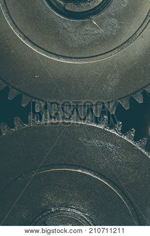 Two linked gearwheels technological background. Close-up photo