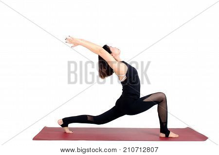 middle aged asian woman doing yoga in Virabhadrasana One or Warrior One yoga pose on the mat isolated on white background exercise fitness sport training healthy lifestyle and people concept