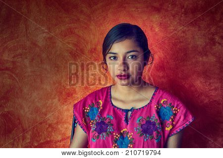 Mexican woman with mayan dress latin ethnicity on orange background