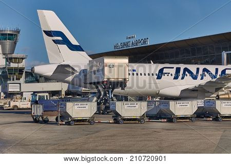 VANTAA, FINLAND - MARCH 23, 2017: Finnair aircraft being loaded with catering products at Helsinki Vantaa International Airport