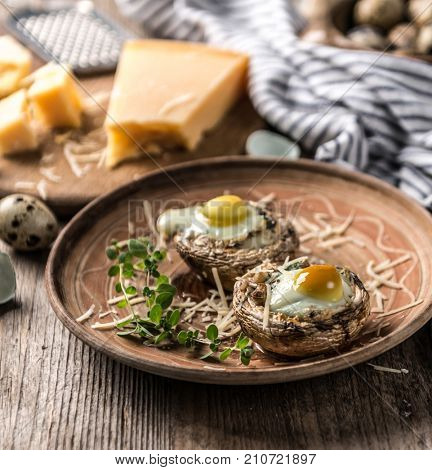 Stuffed mushrooms with quail eggs and parmesan cheese.