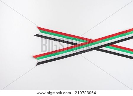A flat ribbon with UAE national day colors. United Arab Emirates celebrate national day on December 2 every year.