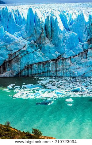 The concept of exotic and extreme tourism. Patagonian province of Santa Cruz, Lake Argentino. On the surface of the glacier Perito Moreno formed Calgaspors -