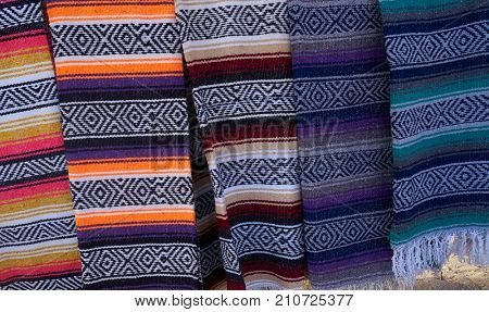 Mexican serape blanket in a row at Mexico outdoor shop