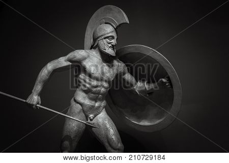 Man in helmet Greek ancient sculpture of warrior