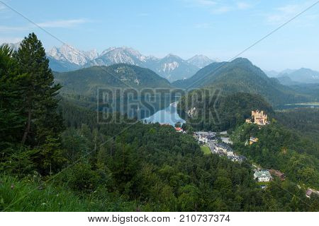 Castle Schwangau with green pine forest and lake. Germany