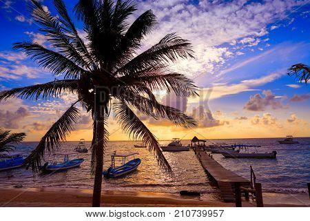 Riviera Maya sunrise pier in Caribbean Mayan Mexico