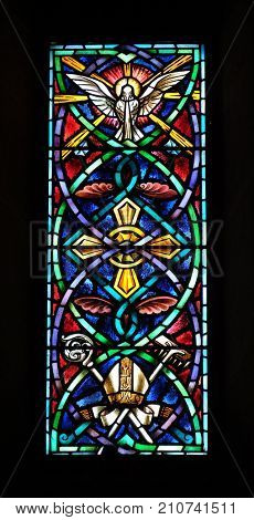 LUCCA, ITALY - JUNE 03: Stained glass window in the Basilica of Saint Frediano, Lucca, Tuscany, Italy on June 03, 2017.