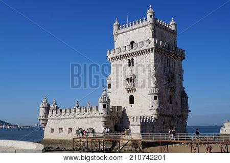 Tour of Belém, Torre de Belém in Portuguese - Lisbon, Portugal The tower of Belém (or Torre de Belém in Portuguese). The tower of Belém was built on the edges of the Tagus in the freguesia of Santa Maria of Belém between 1514 and 1519 by king Manuel