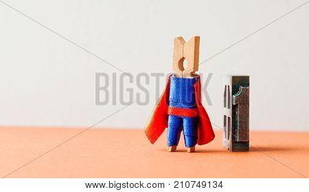 Champion superstar hero won first place. Successful leadership conceptual photography. Brave wooden clothespin superhero character and vintage letterpress digit, copy space.