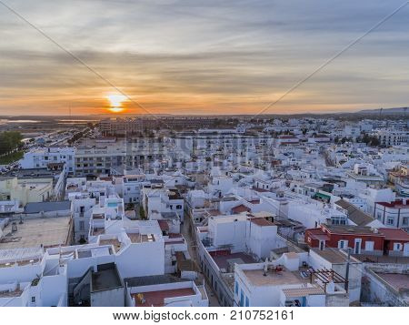 Sunset aerial cityscape in Olhao Algarve fishing village view of ancient neighbourhood of Barreta and its traditional cubist architecture. Portugal.