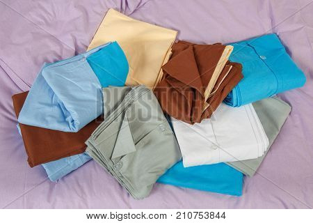 stacks colourful bed linen textiles clothing background pile concept. piles of bed linen