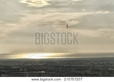 View of two paragliders in front of the sea