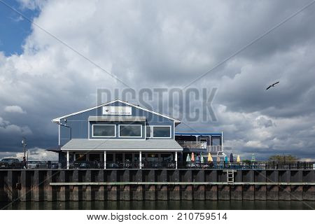 ATLANTIC HIGHLANDS NEW JERSEY - September 30 2017: A view of the On The Deck Restaurant & Harbor View Bar next to teh Atlantic Highlands Marina