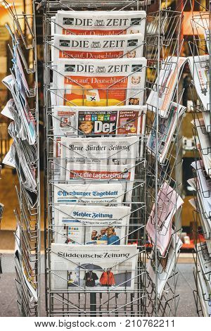 PARIS FRANCE - SEP 25 2017: International and German newspaper at press kiosk with portrait of Angela Merkel after election in Germany for the Chancellor of Germany the head of the federal government
