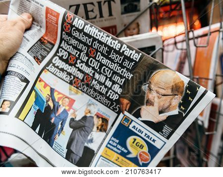 PARIS FRANCE - SEP 25 2017: International newspaper with portrait of Martin Schulz after election in Germany for the Chancellor of Germany the head of the federal government