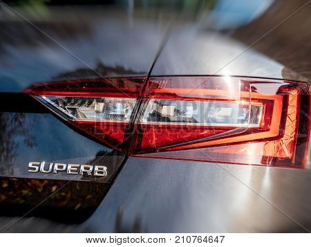 STRASBOURG FRANCE - OCT 1 2017: Focus on the rear view of Skoda Superb luxury limousine made by Skoda part of Volkswagen maroon topaz color