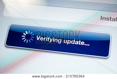 Verifying update message with spinning cursor on a modern tablet screen - tilt shift lens used
