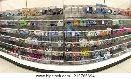 Alameda CA - October 16 2017: Store shelf with baskets of travel and trial sized products. They give customers the opportunity to try a product they might not normally buy with minimum investment.