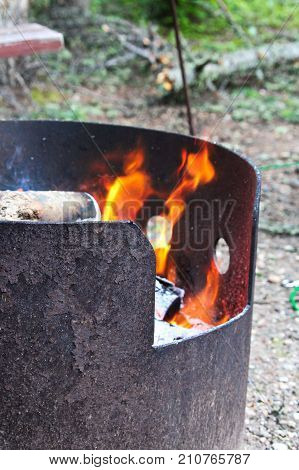 A fire burning in a metal fire ring.