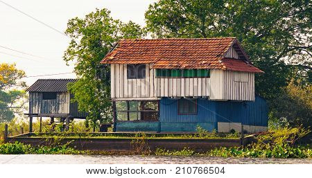 Old Wooden House On The Margins Of A River Of Pantanal, Brazil