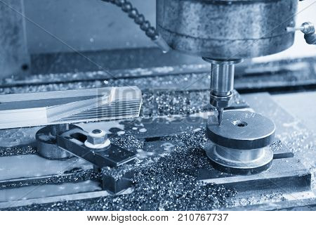 The CNC milling machine cutting cutting the raw material with the indexable tool .Hi-precision CNC machining concept.