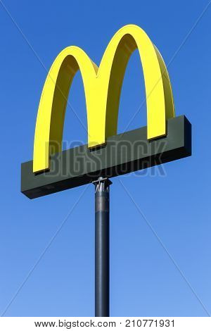 Randers, Denmark - August 19, 2015: McDonald's logo on a pole. McDonald's is the world's largest chain of hamburger fast food restaurants