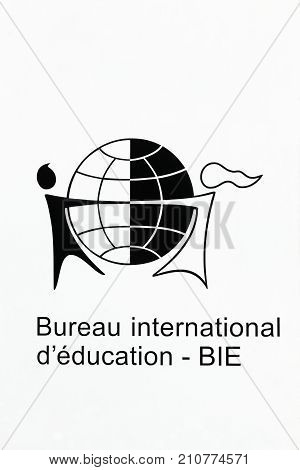 Geneva, Switzerland - October 1, 2017: International Bureau of Education logo on a wall. IBE is a UNESCO category 1 institute mandated as the Centre of Excellence in curriculum and related matters