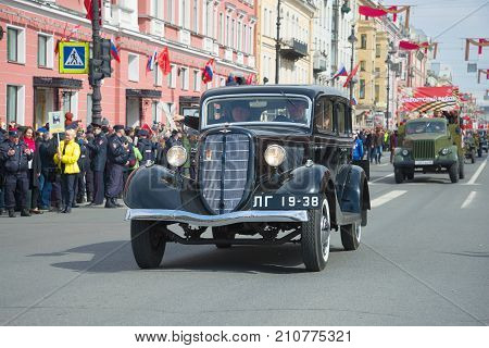 SAINT-PETERSBURG, RUSSIA - MAY 09, 2017: The Soviet car of the Great Patriotic War - GAZ-M1 takes part in a parade of old cars. Victory Day in St. Petersburg