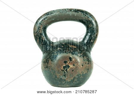 Old black rusty and heavy kettlebell placed on the center isolated on white background