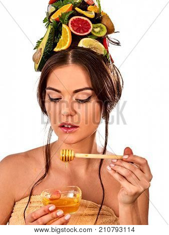 Honey facial mask with fresh fruits for hair and skin on woman head. Girl face hold honeycombs for homemade organic skin and hair therapy. Acceleration of hair growth and masks for face.