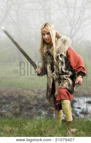 Viking Girl  With Sword In A Fog Wood