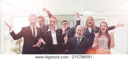 Victory in business. Successful businessman and business team on