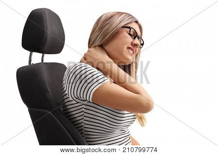 Young woman sitting in a seat and experiencing neck pain isolated on white background
