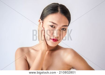 Beauty portrait of young asian woman isolated on white background. Happy beautiful asian tan woman.