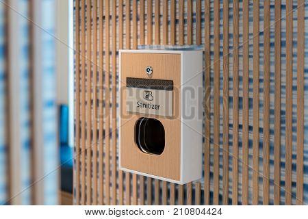 Machine for sanitizing hands outside a public bathroom or washroom in hotel