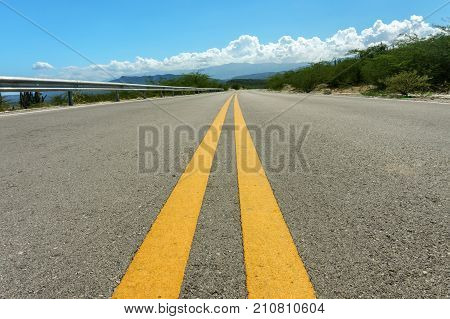 two yellow dividing strips on asphalt road. Speed highway