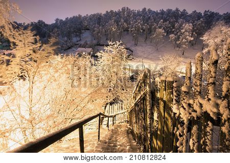 Winter beautiful night landscape. Slow shutter speed. Beautiful landscape. Night landscape. Winter landscape. City landscape. Landscape with a view of the mountains. Winter forest landscape.