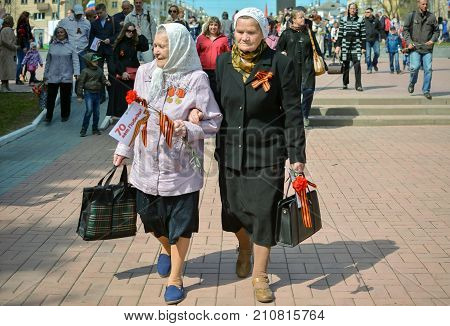 Yoshkar-Ola Russia - May 9 2015 Photo of two grandmothers of veterans of the Second World War in the central park of Yoshkar-Ola Russia