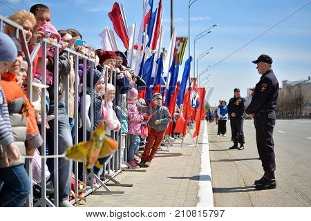 Yoshkar-Ola Russia - 9 May 2015 Photo of people behind the fence during the Victory Parade in Yoshkar-Ola Russia